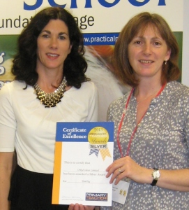 Clare and Deborah receiving an award for TomTag