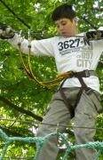 boy balnacing on high ropes trail