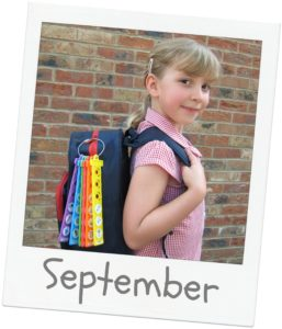 girl carrying backpack with tomtag attached